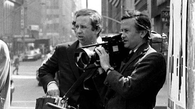 """FILE - In this July 1969 file photo, documentary filmmakers David, left, and Albert Maysles work on the streets of New York for """"Salesman."""" Albert Maysles, who along with his brother David made works of """"cinema verite"""" in the 1960s and '70s, including the Rolling Stones documentary """"Gimme Shelter,"""" died Thursday, March 5, 2015 in New York. He was 88. His brother David Maysles died in 1987.  (AP Photo, File)"""