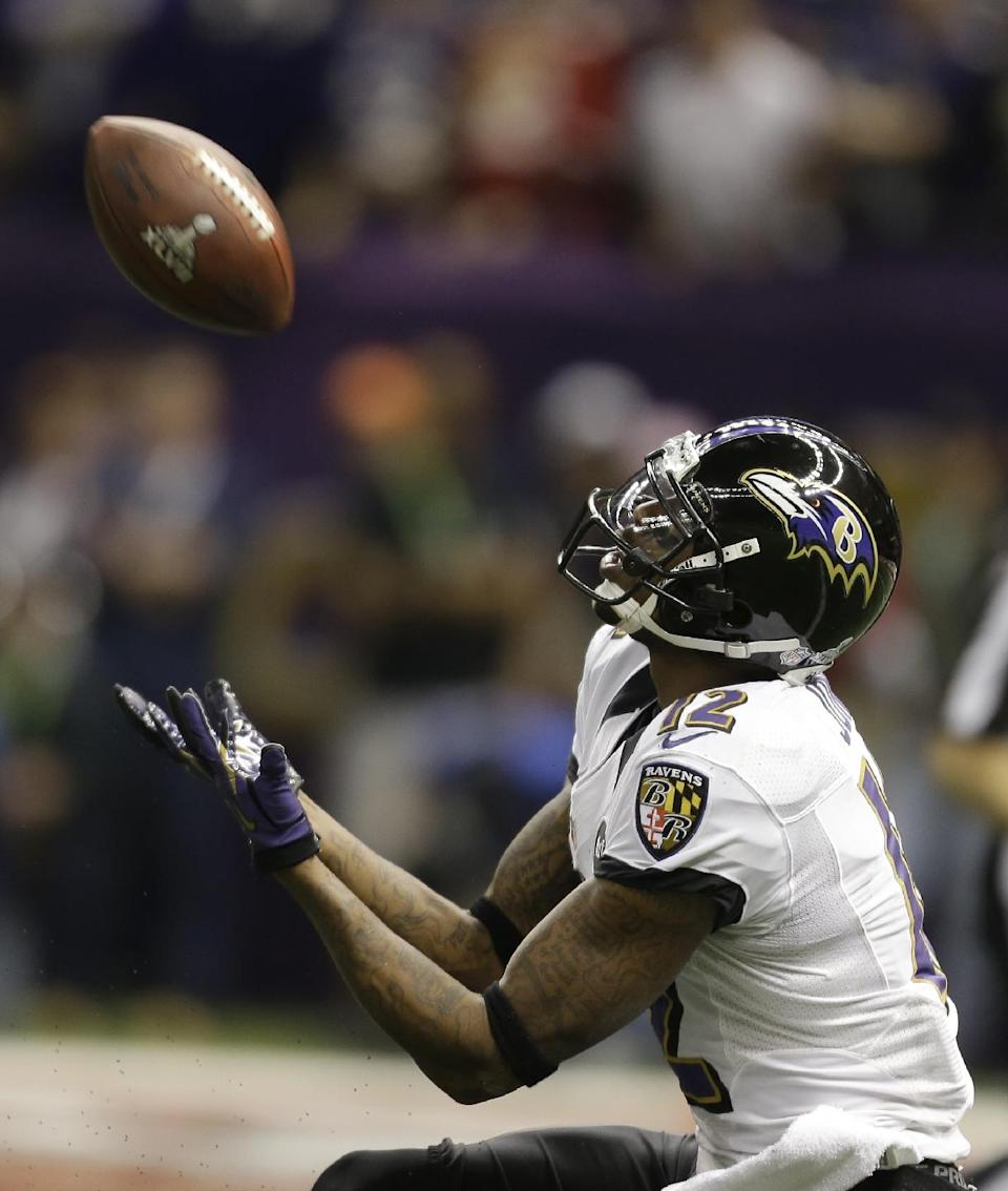 Baltimore Ravens wide receiver Jacoby Jones (12) catches a 56-yard touchdown pass during the first half of the NFL Super Bowl XLVII football game against the San Francisco 49ers, Sunday, Feb. 3, 2013, in New Orleans. (AP Photo/David Goldman)