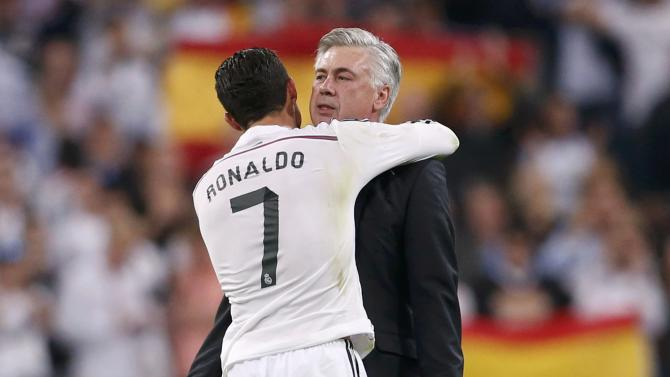 """Real Madrid's Ronaldo embraces his coach Ancelotti after their Spanish first division """"Clasico"""" soccer match against Barcelona at the Santiago Bernabeu stadium in Madrid"""