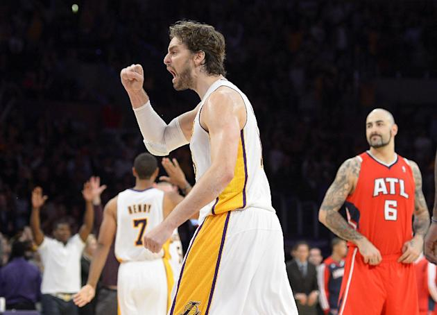Los Angeles Lakers forward Pau Gasol, of Spain, celebrates as Atlanta Hawks center Pero Antic, of Germany, looks on as the Lakers defeat the Hawks 105-103 in their NBA basketball game, Sunday, Nov. 3,