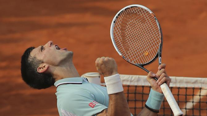 Serbia's Novak Djokovic celebrates defeating Germany's Tommy Haas in three sets 6-3, 7-6, 7-5, in their quarterfinal match at the French Open tennis tournament, at Roland Garros stadium in Paris, Wednesday June 5, 2013. (AP Photo/Michel Euler)