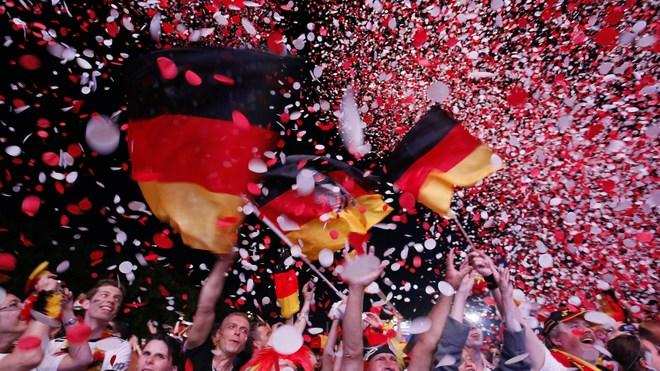 Supporters Of The German National Football Team Cheer With German Flags AFP/Getty Images