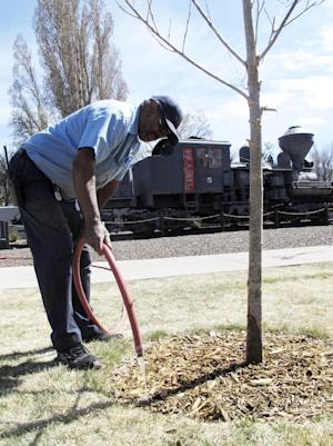 In this April 11, 2014 photo, Richard Booker, a maintenance…