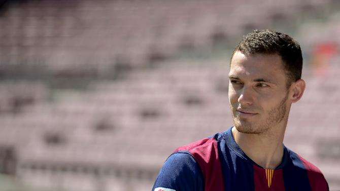 FC Barcelona's defender Thomas Vermaelen poses during his official presentation at the Camp Nou stadium in Barcelona on August 10, 2014