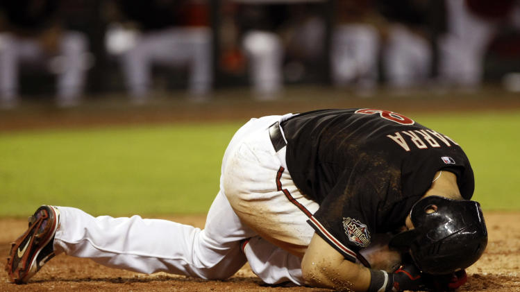 Arizona Diamondbacks' Gerardo Parra reacts at home plate after being hit with a pitch in the seventh inning during a baseball game against the Colorado Rockies on Saturday, July 23, 2011, in Phoenix. (AP Photo/Rick Scuteri)