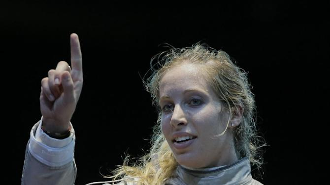 The United States' Mariel Zagunis asks for a ruling in her match against Japan's Seira Nakayama in the women's individual sabre fencing competition at the 2012 Summer Olympics, Wednesday, Aug. 1, 2012, in London.(AP Photo/Dmitry Lovetsky)