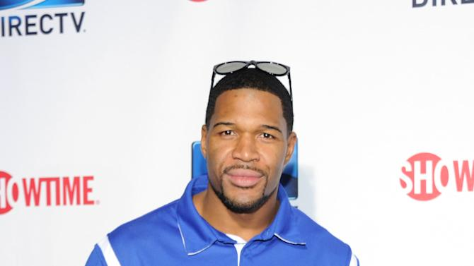 Michael Strahan arrive at DIRECTV's Seventh Annual Celebrity Beach Bowl, on Saturday, Feb. 2, 2013 in New Orleans. (Photo by Evan Agostini/Invision/AP)