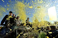 Philippine soldiers on an armoured personnel carrier take part on February 25 in a Manila re-enactment of events leading to the fall of the dictatorship of Ferdinand Marcos. The Philippines said Saturday it will auction off two properties once owned by the late dictator for at least 315.8 million pesos ($7.3 million)