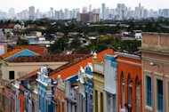 View of a street in Olinda with the city of Recife on the background, on December 09, 2012, Brazil. FIFA Secretary General Jerome Valcke is due back in Brazil next week to tour stadiums in Recife, Belo Horizonte and Rio as the country prepares to mark the 100-day countdown to its hosting of the Confederations Cup