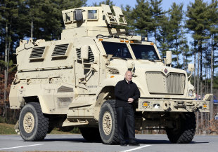 Warren County Undersheriff Shawn Lamouree poses in front the department's mine resistant ambush protected vehicle, or MRAP, on Wednesday, Nov. 13, 201...