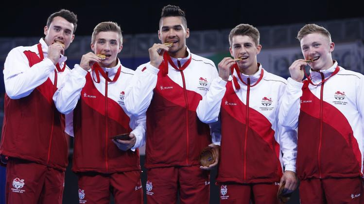 England's team pose with their gold medals after winning the men's team apparatus final of the artistic gymnastics at the 2014 Commonwealth Games in Glasgow, Scotland