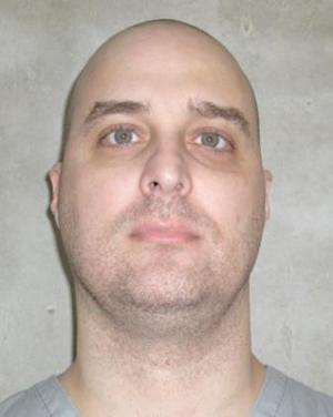 In this photo provided by the Oklahoma Department of Corrections, Michael E. Hooper is pictured in a photo dated June 29. 2011, in McAlester, Okla. Hooper, scheduled for execution Aug. 14, 2012, said he fears that he would be subject to cruel and unusual punishment if the sole dose remaining in Oklahoma of a sedative used in executions isn't enough to keep him from feeling pain as he is put to death. (AP Photo/Oklahoma Department of Corrections)
