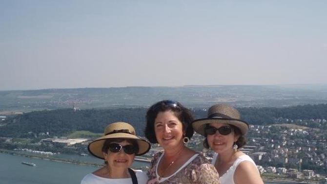 This 2012 photo provided by Anne D'Innocenzio shows her on the right with her sister Donna in the middle and mother Marie on the left in Rudesheim, Germany, on a port call they made while taking a Rhine River cruise together. D'Innocenzio grew up taking family trips with her parents and siblings, and continues to enjoy vacationing with her mother, even though their travel styles sometimes differ and their roles have reversed a bit, with D'Innocenzio doing more of the caretaking for her aging parent. (AP Photo)
