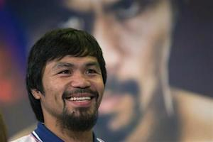 Boxer Manny Pacquiao of the Philippines smiles during a news conference in New York