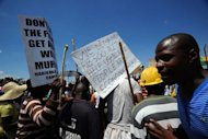 <p>Striking miners stage a protest at the AngloGold Ashanti mine in Carletonville, 84 kms northwest of Johannesburg.</p>
