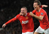 Manchester United's Wayne Rooney (L) and Jonny Evans during a Premier League match on March 26. United will go eight points clear at the top of the league if they beat QPR just before second-placed City kick off at Arsenal