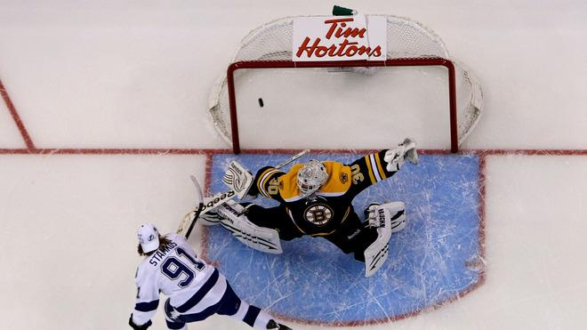 Steven Stamkos #91 Of The Tampa Bay Lightning And Team Alfredsson Scores A Goal Past Goalie Tim Thomas #30 Of The Getty Images