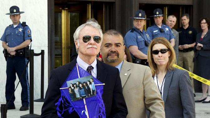 Oregon Gov. John Kitzhaber waits for his introduction at a May Day rally during which he went on to sign Senate Bill 833 into law on the steps of the State Capitol in Salem, Ore. on Wednesday,  May 1,  2013. The bill authorizes driver's cards for those without the documents to obtain regular driver's licenses. (AP Photo/The Oregonian, Beth Nakamura)