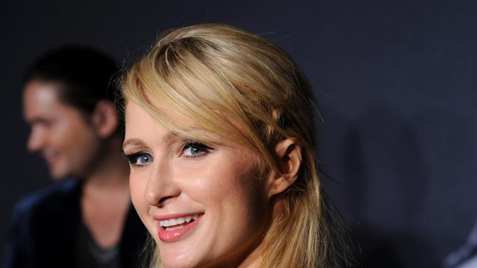 """FILE - In this Sept. 13, 2012 file photo, television personality Paris Hilton arrives at a """"Lady Gaga Fame"""" fragrance launch event at the Guggenheim Museum in New York. Police in Las Vegas say the 21-year-old male model boyfriend of celebrity socialite Paris Hilton received a misdemeanor summons after a scuffle with another man at a Las Vegas Strip nightclub on Monday, Oct. 1, 2012. (Photo by Evan Agostini/Invision/AP, File)"""