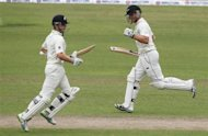 New Zealand's Corey Anderson and Kane Williamson (L) run between the wickets against Bangladesh, during their third day of second test cricket match of the series in Dhaka October 23, 2013. REUTERS/Andrew Biraj