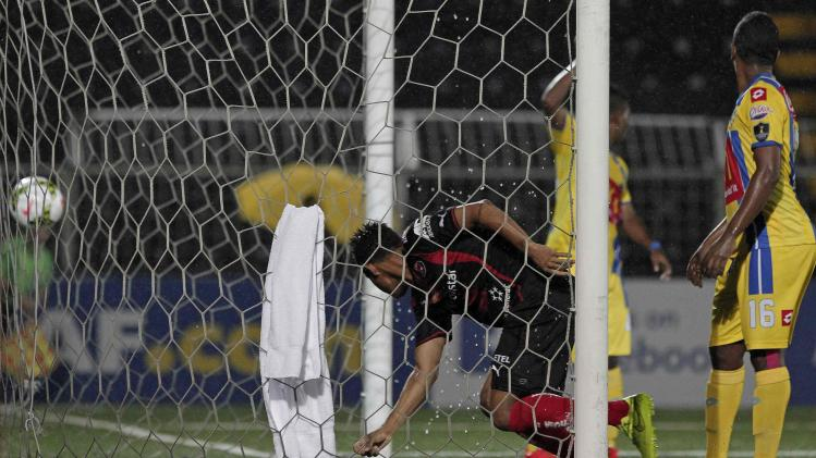 Alonso of Costa Rica's Liga Deportiva Alajuelense scores a goal past Fonseca of Panama's Chorrillo FC during their CONCACAF Champions League soccer match in Alajuela City
