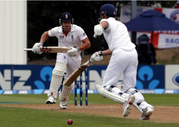 England's Compton takes a run with captain Cook during the fourth day of the first test against New Zealnd at the University Oval in Dunedin
