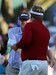 ST LOUIS, MO - MAY 24:  Russ Cochran and Kenny Perry shake hands on the ninth hole green following Round Two of the Senior PGA Championship presented by KitchenAid at Bellerive Country Club on May 24, 2013 in St Louis, Missouri.  (Photo by Christian Petersen/Getty Images)