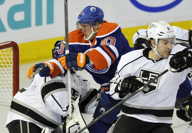 Oilers' Hemsky runs into Kings' Quick and Doughty during their NHL hockey game in Edmonton