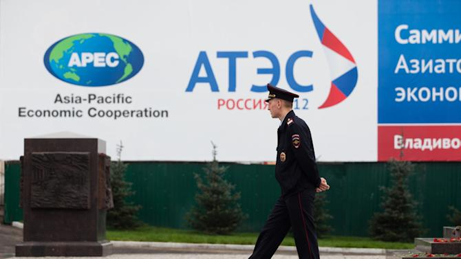 A police officer patrols the central business district of Vladivostok, Russia, Saturday, Sept. 8, 2012. Leaders from the APEC countries are attending their annual summit in the eastern Russian city till Sept. 9.  (AP Photo/Alexander Khitrov)