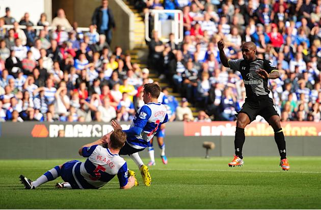Jermain Defoe, right, scored two goals as Tottenham beat Reading