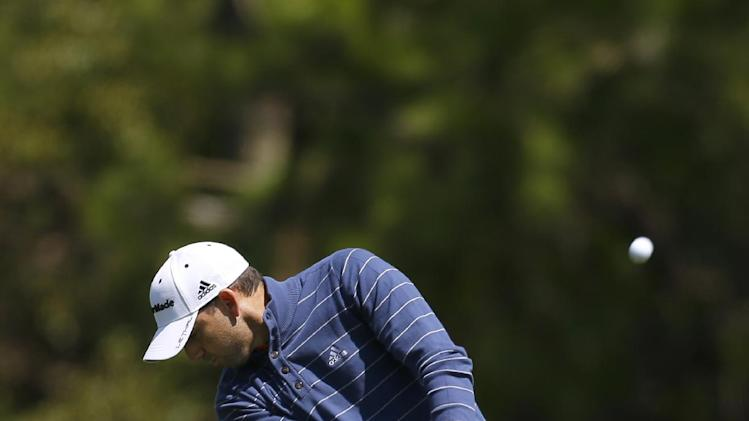 Sergio Garcia, of Spain, chips from the seventh fairway during the first round of the Tampa Bay Championship golf tournament Thursday, March 14, 2013, in Palm Harbor, Fla. (AP Photo/Chris O'Meara)