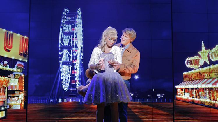 COMMERCIAL IMAGE - Actors Lauren Zakarin and Marshal Kennedy Carolan on stage during a  rehearsal performance of Surf the Musical featuring 136 Sharp LED monitors as seen on Wednesday June 13, 2012 in Las Vegas. Surf the Musical is a new headlining show at Planet Hollywood Resort and Casino. (Photo by Joe Kohen,Invision for Sharp /AP Images)