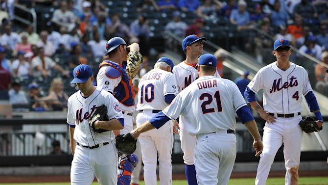New York Mets first baseman Lucas Duda (21) taps starting pitcher Dillon Gee (35) with his glove after manager Terry Collins (10) takes Gee out of the game in the seventh inning of a baseball game against the Philadelphia Philies at Citi Field on Sunday, Aug. 31 2014, in New York. (AP Photo/Kathy Kmonicek)