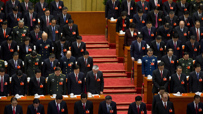 China's communist leaders bow in silence in remembrance of the late leaders during the opening session of the 18th Communist Party Congress held at the Great Hall of the People in Beijing, China, Thursday, Nov. 8, 2012. Preparing to hand over power after a decade in office, China's President Hu Jintao called Thursday for sterner measures to combat official corruption that has stoked public anger while urging the Communist Party to maintain firm political control. Front row from left to right, Li Peng, former Chinese Premier, He Guoqiang, head of  Central Commission for Discipline Inspection, Xi Jinping, Chinese Vice President, Jia Qinglin, Chairman of Chinese People's Political Consultative Conference, Wu Bangguo, Chairman of National People's Congress, Hu Jintao, Chinese President and Communist Party chief, Jiang Zemin, former Chinese President and the party chief, and Wen Jiabao, Chinese premier. (AP Photo/Alexander F. Yuan)