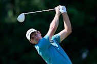 Justin Rose of England watches his tee shot on the ninth hole during the third round of the Tour Championship at East Lake Golf Club in Atlanta, Georgia. Rose fired a two-under par 68 to match American Brandt Snedeker for the lead after Saturday&#39;s third round
