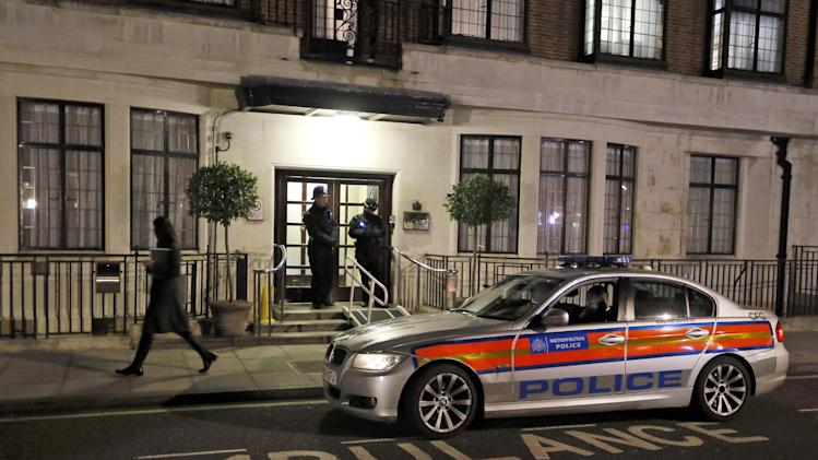 Police keep watch outside a hospital in central London, Tuesday, Dec. 4, 2012. Kate, The Duchess of Cambridge is being treated at the hospital for severe morning sickness. (AP Photo/Kirsty Wigglesworth)