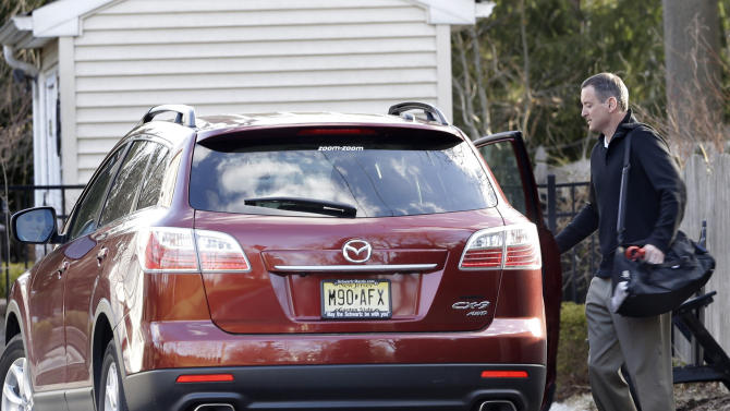 "Former Rutgers men's basketball coach Mike Rice leaves his home Wednesday, April 3, 2013, in Little Silver, N.J. Rice was fired Wednesday after a videotape aired showing Rice using gay slurs, shoving and grabbing his players and throwing balls at them in practice. Athletic director Tim Pernetti was given a copy of the tape by a former employee in November and, after an independent investigator was hired to review it, Rice was suspended for three games, fined $75,000 and ordered to attend anger management classes. University president Robert Barchi signed off on the penalty. But on Wednesday, Rutgers referred to new information and ""a review of previously discovered issues"" as the reasons for Rice's termination. (AP Photo/Mel Evans)"