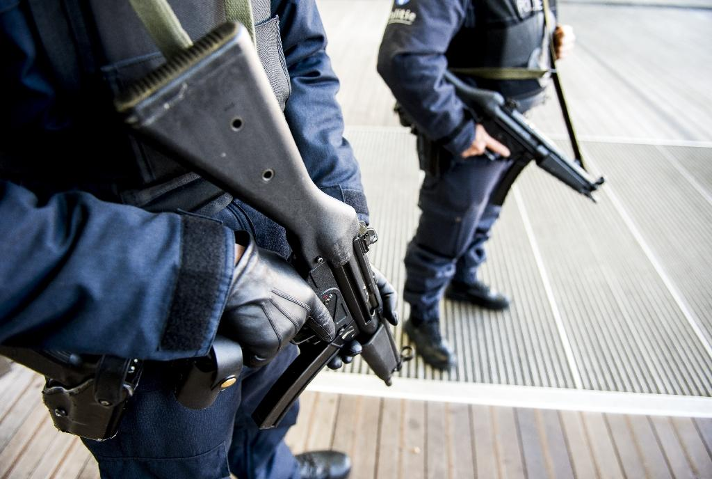 Belgium charges four after nationwide anti-terror raids