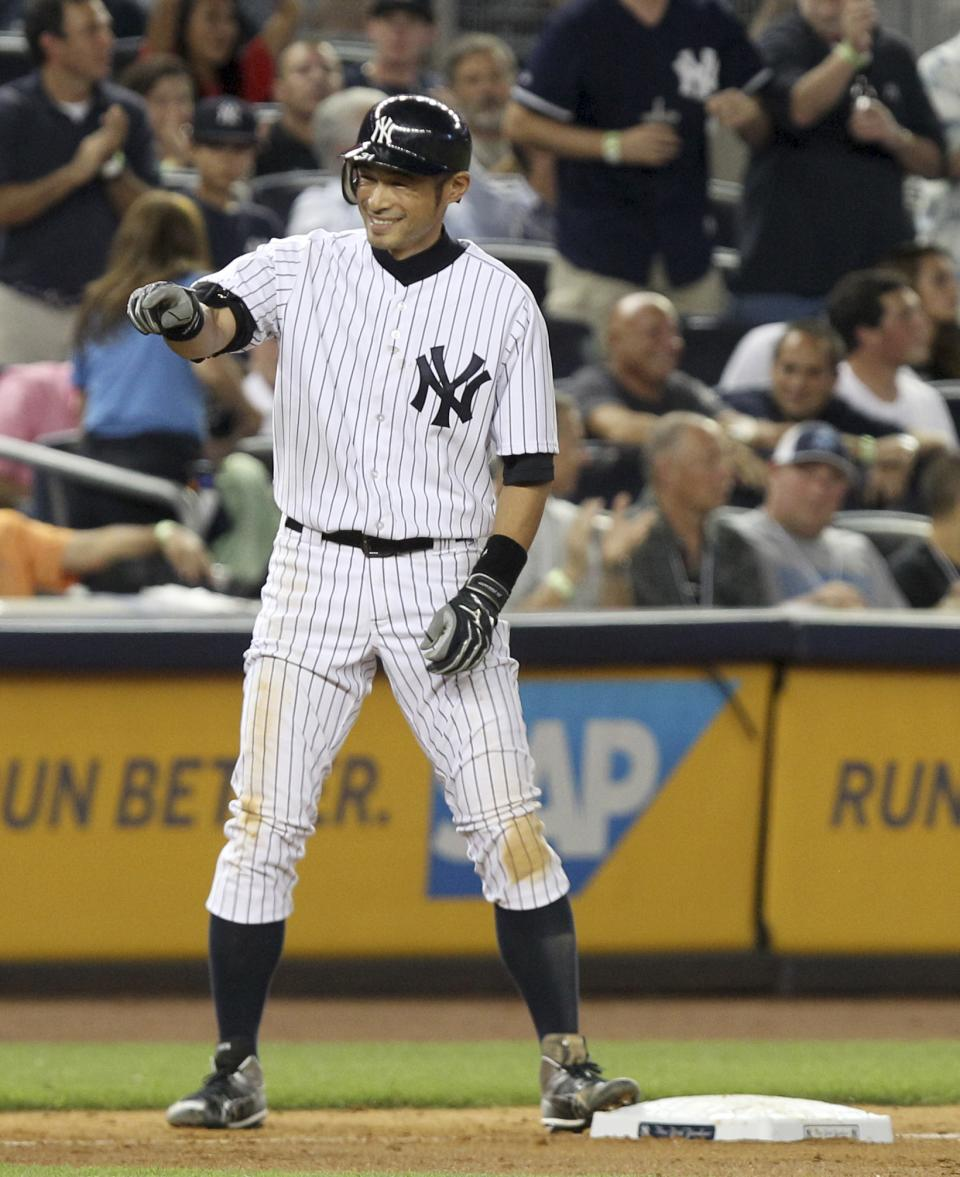 New York Yankees' Ichiro Suzuki reacts after hitting a triple during the seventh inning of the baseball game against the Texas Rangers Monday, Aug. 13, 2012 at Yankee Stadium in New York.  (AP Photo/Seth Wenig)
