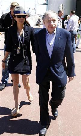 Former Ferrari team manager and current FIA President Jean Todt and his girlfriend Michelle Yeoh walk in the paddock area before the Monaco F1 Grand Prix