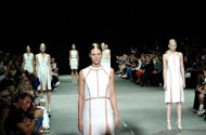 Models walk the runway at the Alexander Wang Spring 2013 fashion show at NY fashion week on September 8. Models stepped out in monochrome looks that included tailored shirt dresses and an generously sized biker jacket