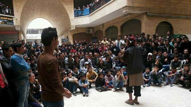 In this picture released Thursday, Nov. 28, 2013, and posted on the Facebook page of a militant group, a member of the al-Qaida linked Islamic State of Iraq and the Levant (ISIL) gives a lecture at the Engineering College in the northern city of Raqqa, Syria. The growing muscle of an al-Qaida linked Syrian group is casting a grim shadow over northern Syria, where extremist militants have turned their attention to seizing activists who cover their country's war on its front lines. (AP Photo)