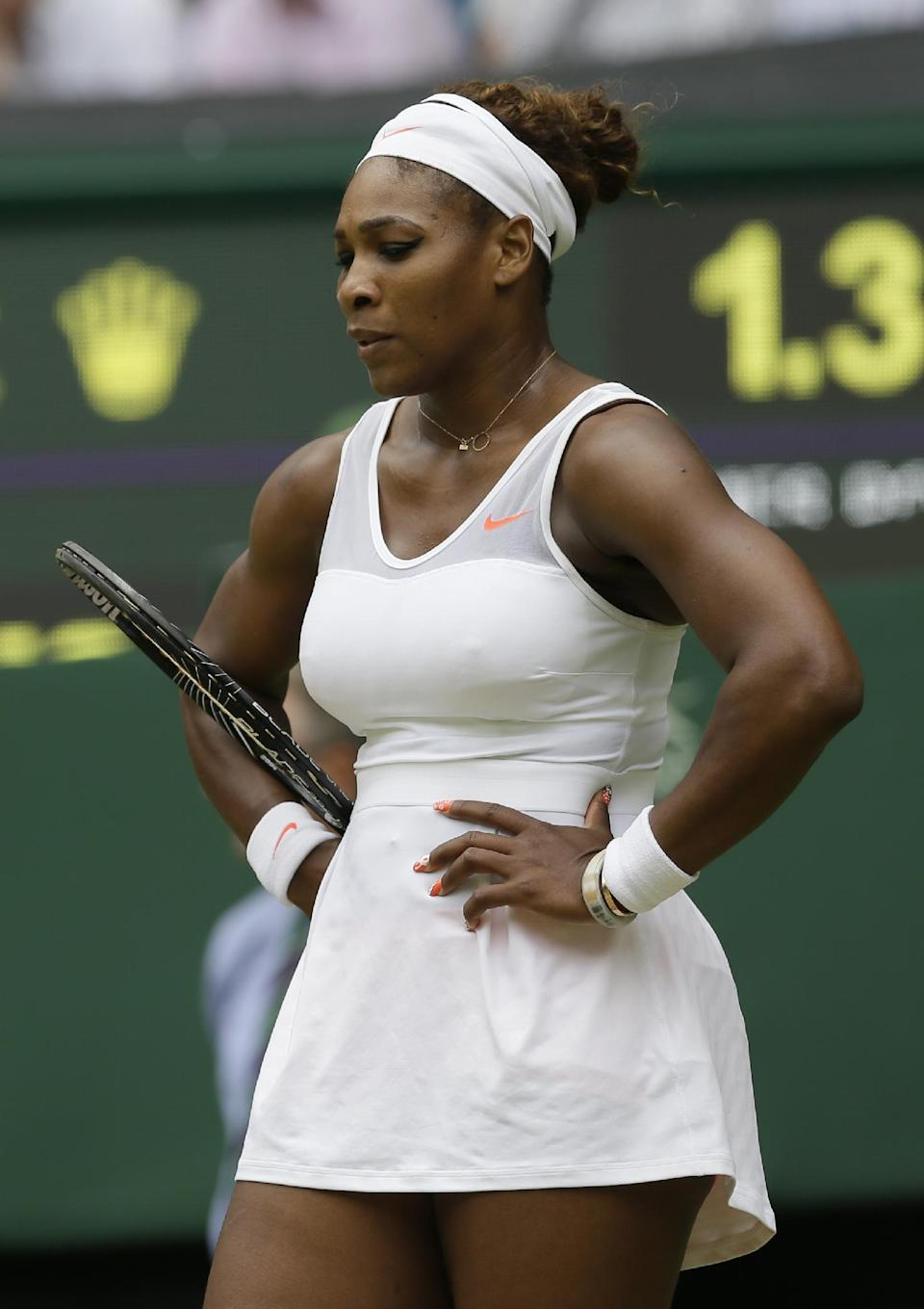 Serena Williams of the United States reacts during her Women's singles match against Sabine Lisicki of Germany at the All England Lawn Tennis Championships in Wimbledon, London, Monday, July 1, 2013. (AP Photo/Alastair Grant)