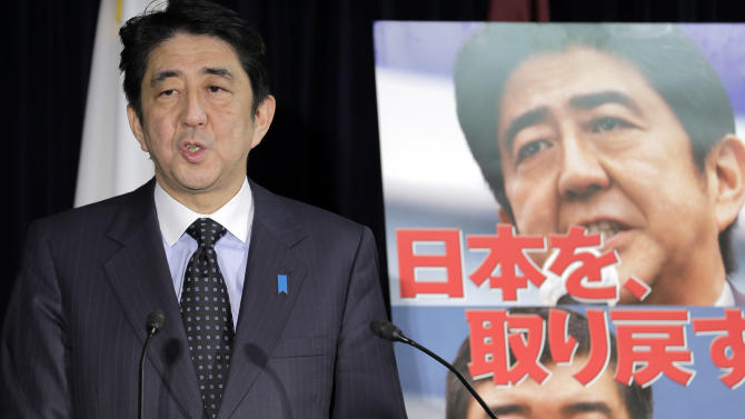 "Japan's largest opposition Liberal Democratic Party leader Shinzo Abe, standing by the party poster reading: ""We get back Japan,""  speaks during a press conference in Tokyo, Friday, Nov. 16, 2012 after the lower house of parliament was dissolved. Prime Minister Yoshihiko Noda dissolved the lower house of parliament Friday, paving the way for elections in which his ruling party will likely give way to a weak coalition government divided over how to solve Japan's myriad problems. Abe, who had a one-year stint as prime minister in 2006 and 2007, now has a chance to return if the LDP wins the most seats in elections expected in mid December. (AP Photo/Koji Sasahara)     (AP Photo/Koji Sasahara)"