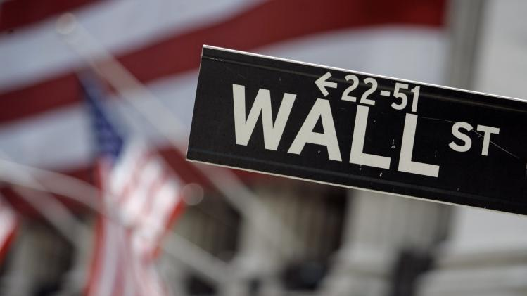 FILE - This May 11, 2007 file photo shows a Wall Street sign in front of the flag-draped facade of the New York Stock Exchange. U.S. stocks are opening lower Wednesday, Aug. 20, 2014, after two straight days of gains. (AP Photo/Richard Drew, File)