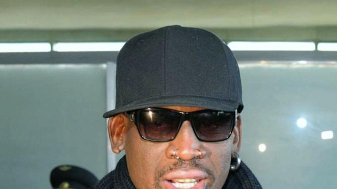 """Former NBA star Dennis Rodman speaks to the media at the Pyongyang Airport in Pyongyang, before he leaves North Korea Friday, March 1, 2013.  Ending his unexpected round of basketball diplomacy in North Korea on Friday, Rodman called leader Kim Jong Un an """"awesome guy"""" and said his father and grandfather were """"great leaders.""""  (AP Photo/Kyodo News) JAPAN OUT, MANDATORY CREDIT, NO LICENSING IN CHINA, HONG KONG, JAPAN, SOUTH KOREA AND FRANCE"""