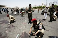 Yemeni military police collect evidence at the site of a suicide bomb attack in Sanaa on Monday. Yemeni police officer Colonel Abdul Hamid Bajjash, in charge of security at the blast area, said the attack &quot;bears the hallmark of Al-Qaeda.&quot;