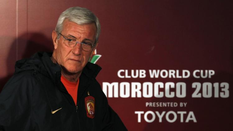 Lippi, coach of China's Guangzhou Evergrande, looks on after a news conference in Agadir