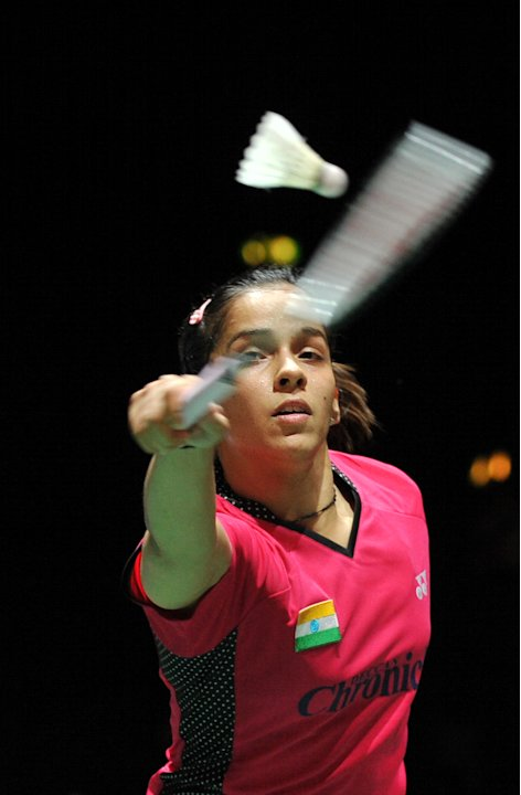 India's Saina Nehwal returns a shot to C