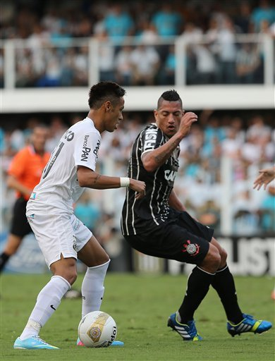 Santos' Neymar, left, controls the ball against Corinthians' Ralf during the final match of the Sao Paulo State soccer league in Santos, Brazil, Sunday, May 19, 2013. Corinthians won 3-2 on aggregate 